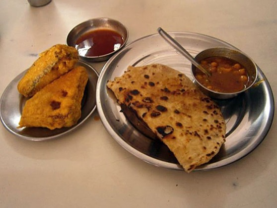 2. Breakfast - Paratha - fried bread, Chana - chickpeas curry, Fried slices of bread with sweet sauce